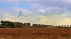 4K Dutch agricultural scenery with wind turbine towers rotating Stock Footage