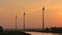 4K turbine towers rotating on sunset Stock Footage