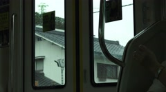 Inside Train Car Tokyo Houses And Buildings Pass By 4K Stock Footage