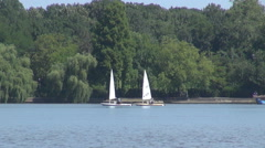 Two small sail boats on lake water sports adventure, modern expensive relaxation Stock Footage