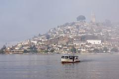 Boat on Lake Patzcuaro with Janitzio Island in Background, Patzcuaro, Michoacan, Stock Photos