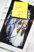 Smashed Wedding Photo With See Ya Written on a Sticky Note Stock Photos