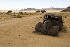 Old Abandoned Car on Side of Dirt Road, Aus, Karas Region, Namibia Stock Photos