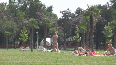 Women have some sunbathe get black skin tanning people in park naked green space - stock footage