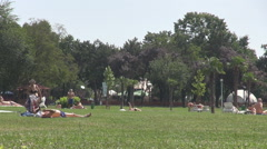 Green space in tanning resort people have fun sunbathe and relax outdoor, meadow Stock Footage