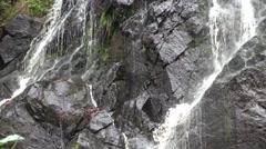 4k Schistous rock waterfall pan right closeup Stock Footage