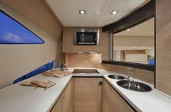 View of Kitchen Aboard Abacus 62 Motorboat Stock Photos