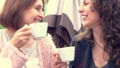 Beautiful women drinking coffee in cafe and talking Stock Footage