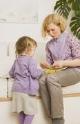 Mother Playing with Daughter - stock photo