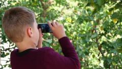 Boy Taking Picture Of Nature 4k Stock Footage