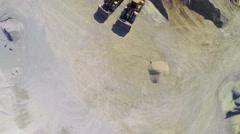 Flying over mining bulldozers standing still Stock Footage