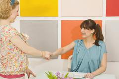 Two Women Shaking Hands Stock Photos
