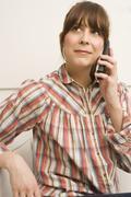 Woman Using Cellphone - stock photo