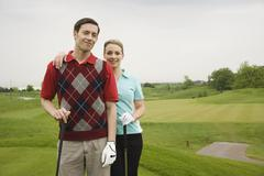 Portrait of Couple Standing on Golf Course - stock photo