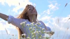 Happy girl with long hair catching soap bubbles outdoor - stock footage
