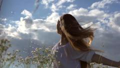 Beautiful young woman over cloudy sky Stock Footage