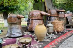 russian samovar and old copper tanks for making traditional georgian vodka - stock photo