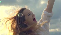 Happy girl with long hair having fun outdoor Stock Footage