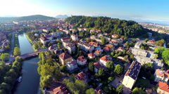Aerial shot of Ljubljana city with Ljubljanica and castle at sunset Stock Footage