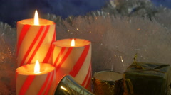 Christmas striped candle trio closeup 4k - stock footage