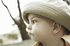 Little Boy With Hat Biting His Lower Lip - stock photo