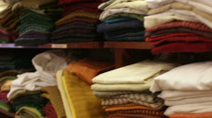 Clothes lying on the shelves in the store Stock Footage