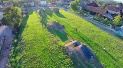 Person bicycling on stunt track aerial footage Stock Footage