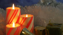 Christmas striped candle trio closeup - stock footage