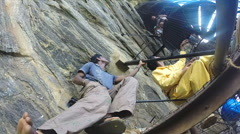 Sri Lankan workers renovating stairs leading to wall fresco painting. - stock footage