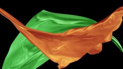 Stock Video Footage of Orange and green color fabrics flying in midair, Slow Motion