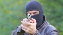 A man in balaclava shooting with a gun Stock Footage