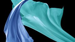 Blue and green color fabrics flying in midair, Slow Motion Stock Footage