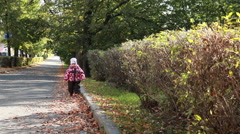 Kid alone walking in the autumn Park. - stock footage