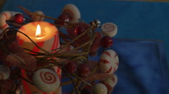 red and white christmas candle and wreath - stock footage