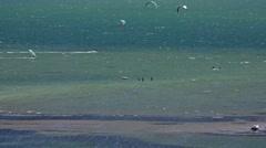 Windsurfers and kitesurfers riding in sea. High angle view, La Manga, Spain. Stock Footage