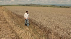 Farmer Looking at a Wheat Field Work Satisfaction Concept Stock Footage