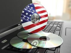 Stock Illustration of software made in usa cd on laptop keyboard. compact disks.