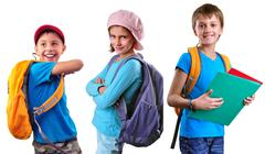 Schoolchildren of grade school with backpack and books Stock Photos