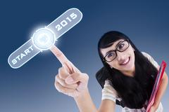 College student with a start button to future Stock Illustration