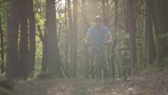 SLOW MOTION: Biker riding downhill bike in the woods - stock footage