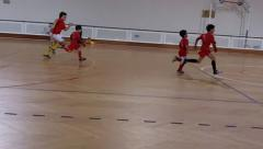 Kids Warming up to play indoor Football Stock Footage