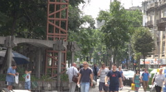 People in summer days move in center city area, crowded place in town, business Stock Footage