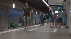 Public transport people in subway station commuter wait train underground travel Stock Footage