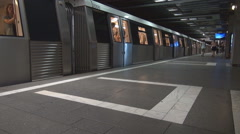 Subway train leaves station, fast motion underground, commuters transit faster Stock Footage