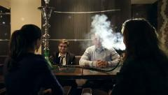 Company people enjoy hookah and communication. HD shot with slider Stock Footage