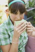 Woman Drinking a Cup of Coffee - stock photo