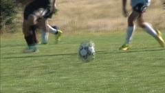 High school boys soccer players compete on grass field Stock Footage