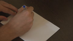 Close up blank sheet paper, man hand writing positive message, welcome, hello Stock Footage