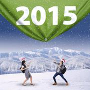 Stock Illustration of two students with number 2015 in winter