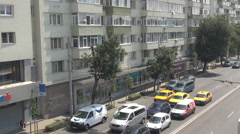 Aerial view car traffic, full lanes with cars stop at red traffic light, motion Stock Footage